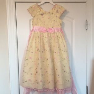 Spring yellow dress with frills and flowers.